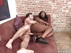 Horny white stud deeply penetrates slutty black cutie.